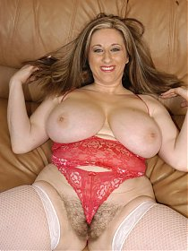 Curvy babe Kitty shows off her monster size tits and full pussy bush before stripping down and getting stuffed doggie style